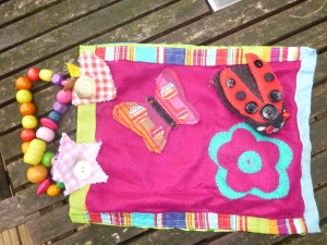Activity bag with velcro butterfly and ladybird
